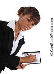 Woman writing in her agenda