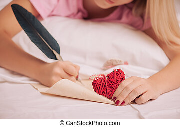 Woman writing love letter with feather pen
