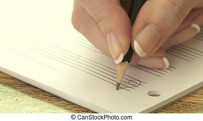 Woman writing music notation
