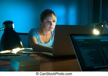 Woman Writing On Laptop Computer Late At Night - Beautiful...