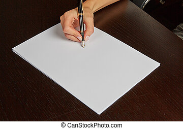 Woman writing on white paper