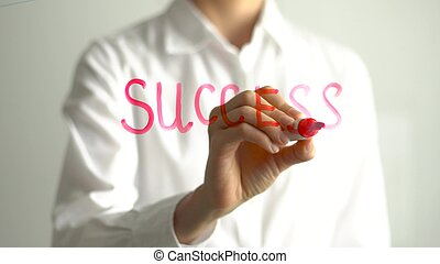 Woman writing Success on transparent screen. Businesswoman write on board