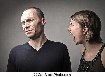 Woman yelling at man - Mad woman yelling at man