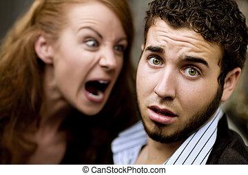 Young woman yells at man with beard