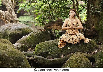 woman  yoga in forest
