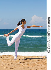 woman yoga on beach
