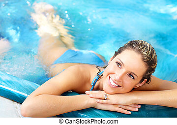 Woman - Young woman relaxing in the water. Summer.