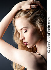 womanly - Portrait of a gorgeous blonde woman with sensual...