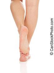 Woman's bare feet. - Woman's smooth caucasian bare feet.