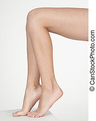 Woman's Bare Legs - Close up of woman's bare legs against a ...