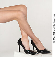 Woman's Bare Legs in Heels - Close up of woman's bare legs ...
