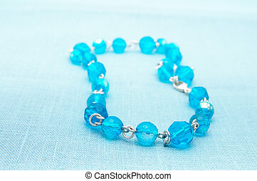 womans blue glass bead necklace