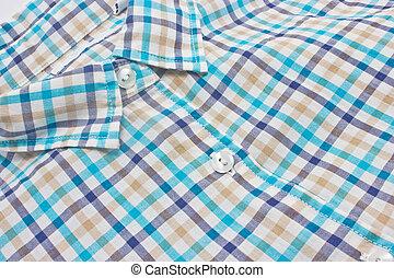 Woman's checked shirt close up.