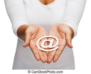 woman's cupped hands showing e-mail cutout sign