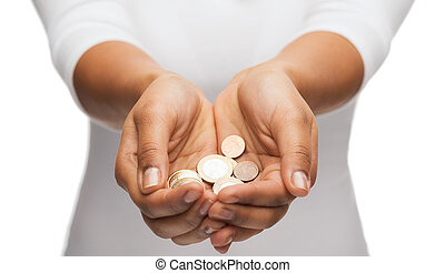 womans cupped hands showing euro coins