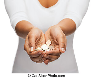 woman's cupped hands showing euro coins