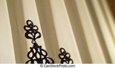 Woman's earring on lamp silhouette