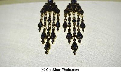 Woman's earrings on white background - Woman's earrings on...
