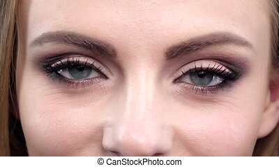 Woman's eye, squint. Close up. Slow motion