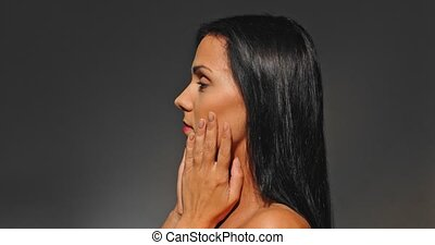Woman's face - anti-aging concept - Side view on nude woman...