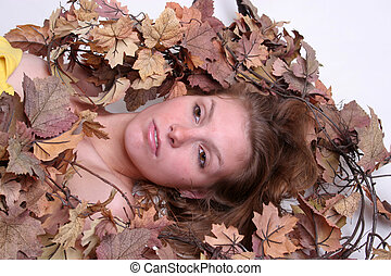 Woman's face in leaves