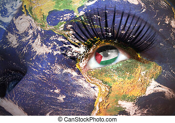 womans face with planet Earth texture and palestinian flag inside the eye. Elements of this image furnished by NASA.