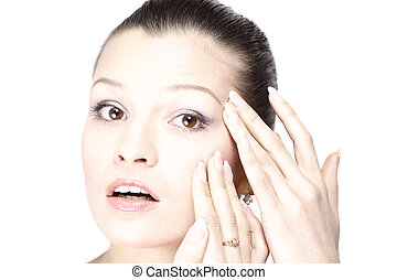 Woman's face with the wrinkles on her forehead