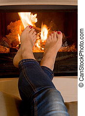 woman's feet in front of a fire