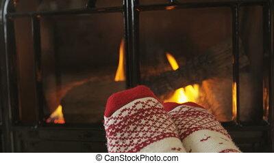 Woman's Feet In Socks Against Fireplace - Girl Wearing Socks...