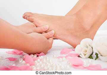 Woman's Feet Receiving Foot Massage - Close-up Of Woman's...