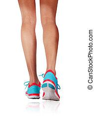Womans feet running in studio. - Detail of a woman legs ...