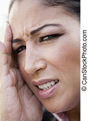 Woman\'s frustrated face outdoors (selective focus)