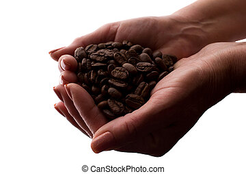 Woman's hand a handful of coffee beans - silhouette