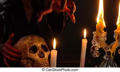 Woman's hand above candle - Footage of woman during ritual...