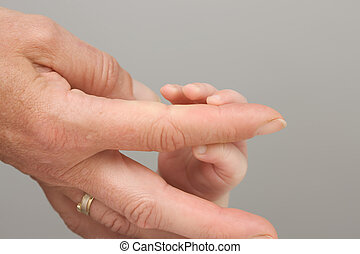 Woman's hand and Baybfinger