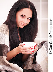 Woman's hand holding a cup of coffee. With a beautiful winter manicure. Drink, fashion, morning
