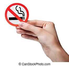 woman's hand holding a symbol - no smoking. Isolated