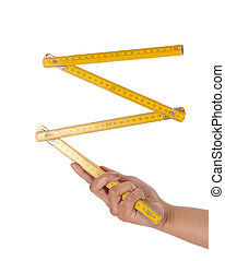 Woman's hand holding a wooden ruler