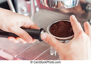 Woman's hand holding coffee grind in group with vintage style