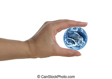 womans hand holding earth