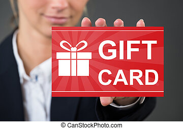 Woman's Hand Holding Gift Card