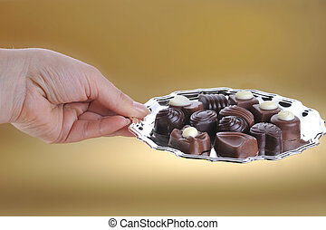 hand holding plate with chocolate