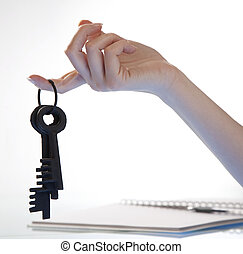 Woman's hand holding retro keys - Woman's hand gently...