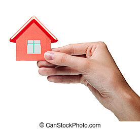 woman's hand holding sign of the house. Isolated