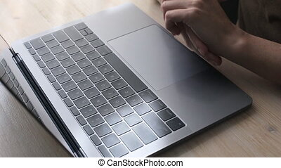 Woman's hand nervous movements near her laptop