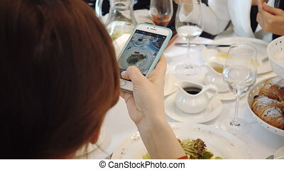 Woman's hand smartphone take pictures of breakfast