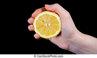Woman's Hand Squeezing Lemon