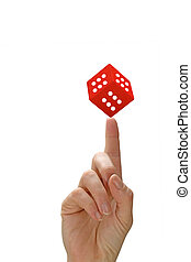 Woman's hand with a finger pointing and red dice