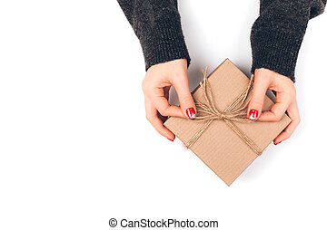 Woman's hand with gift box