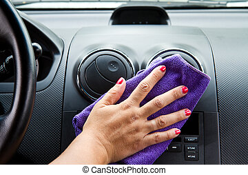 Woman's hand with microfiber cloth polishing  a car